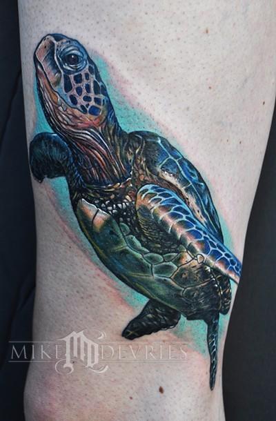 Beautiful sea turtle tattoo by Mike Devries
