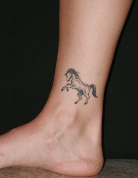 Beautiful small horse ankle tattoo