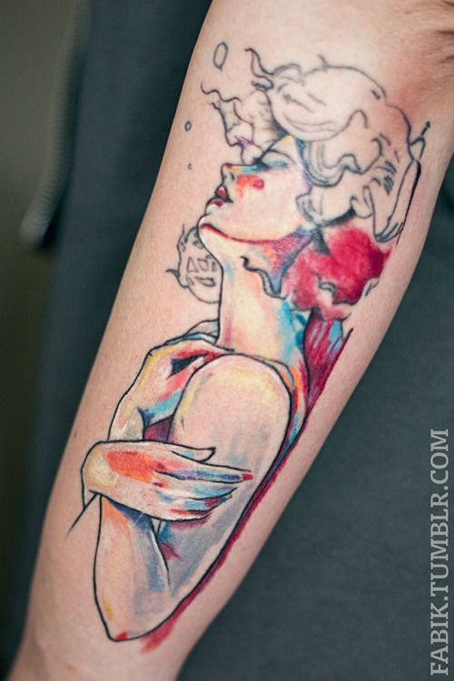 Beautiful style painted and colored big woman tattoo on arm