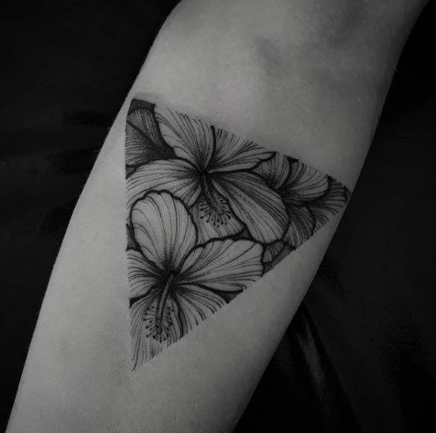 Beautiful triangle shaped black ink forearm tattoo of magnificent flowers