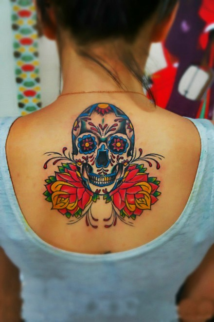 Beautiful vivid colors sugar skull tattoo on back for girls