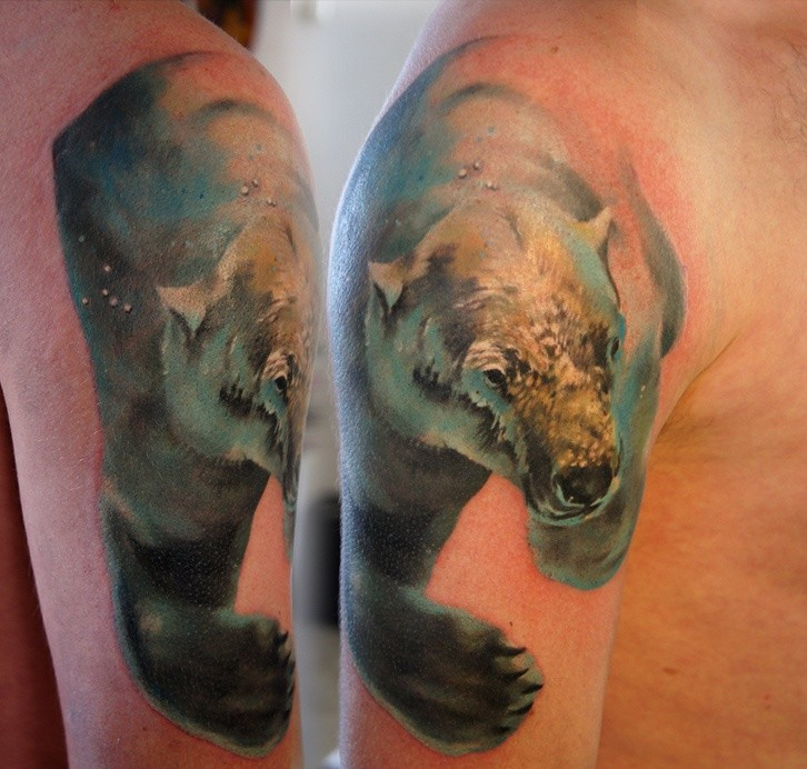 Beautiful watercolor polar bear in water tattoo on shoulder
