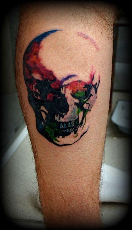 Beautiful watercolor skull tattoo on leg