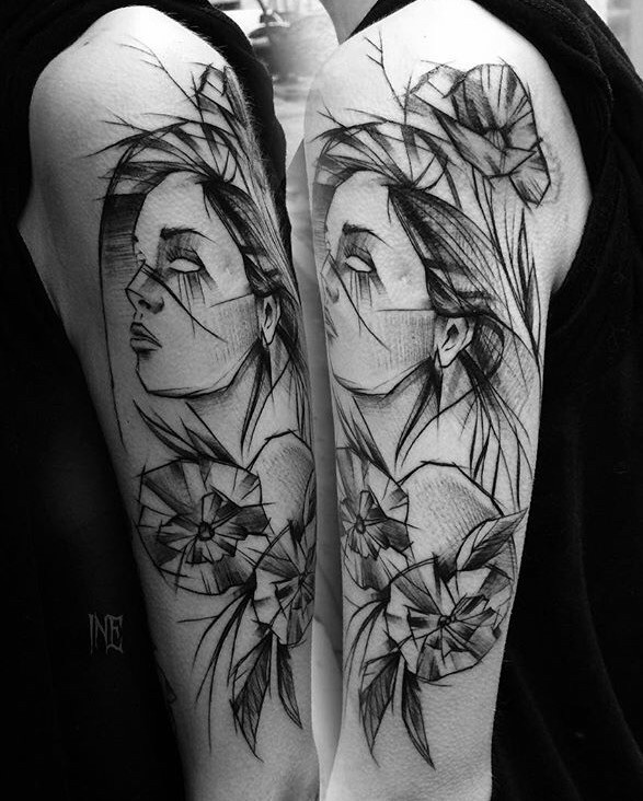 Beautiful woman portrait sketch tattoo painted by Inez Janiak on upper arm with flowers