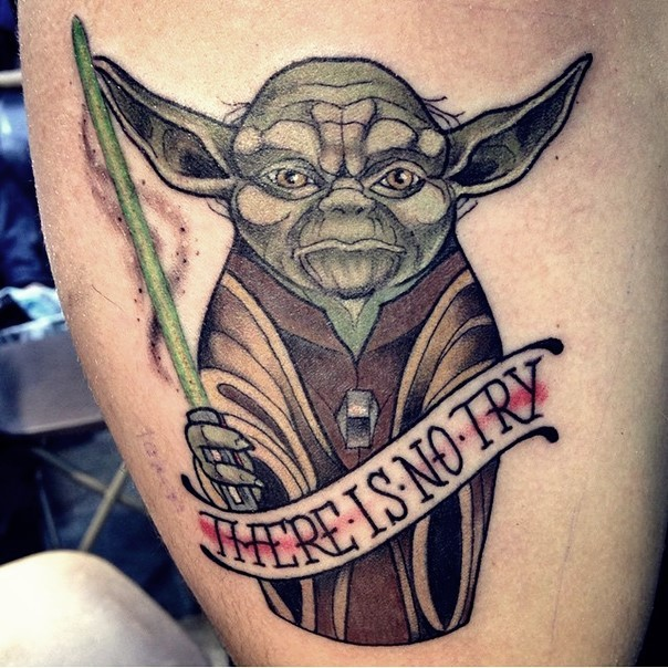 Bic comic books style colorful master Yoda tattoo stylized with lettering