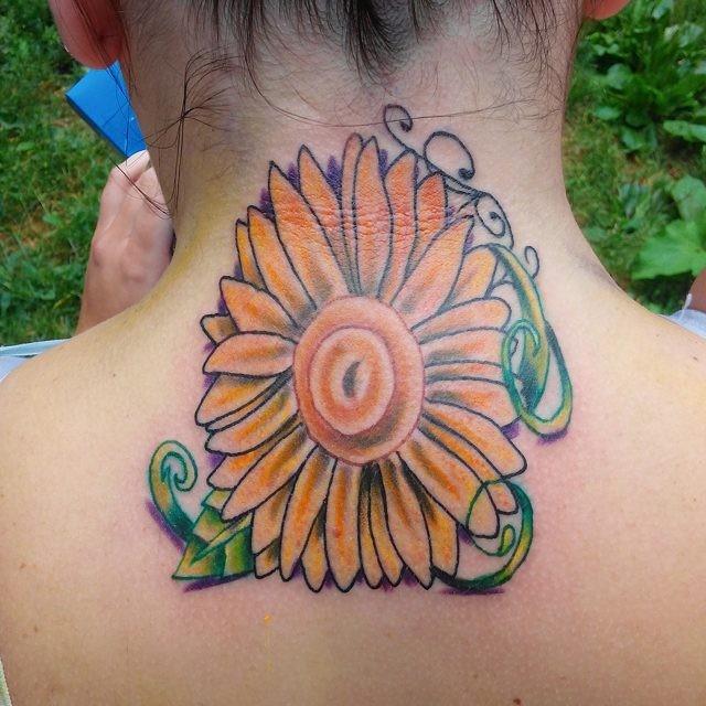 Big 3D like colored neck tattoo of beautiful flower