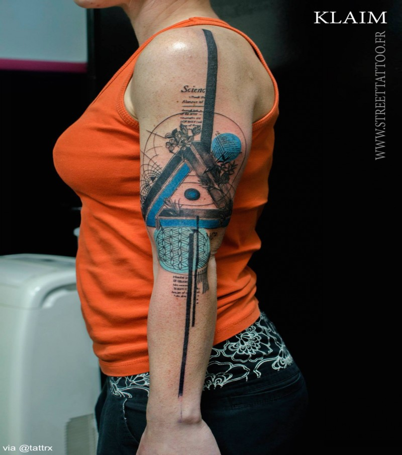 Big amazing looking arm tattoo of mystical symbol with lettering