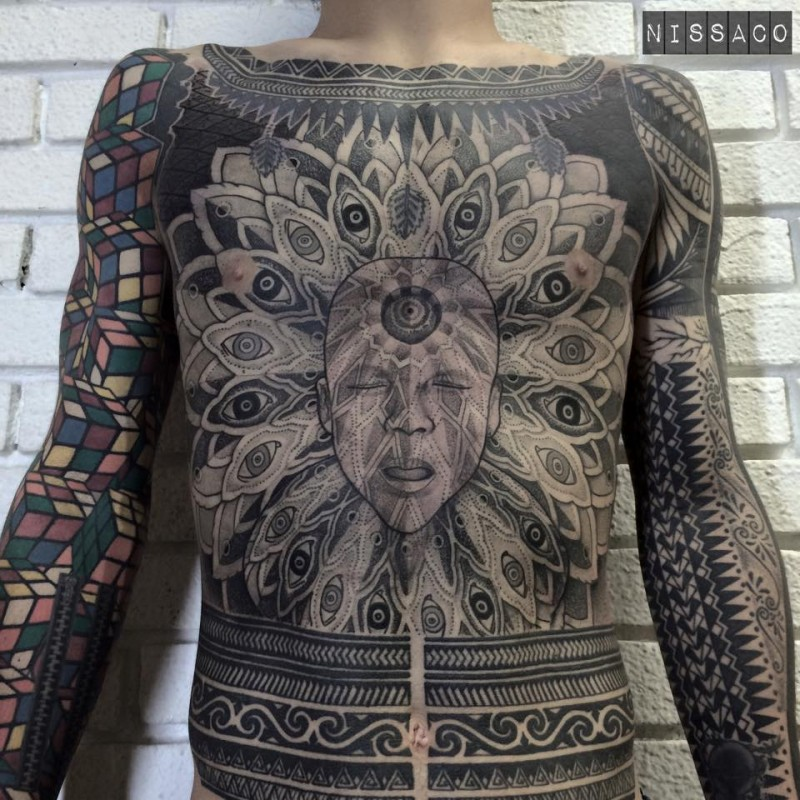 Big amazing painted and detailed whole body tattoo of mystic face with ornaments