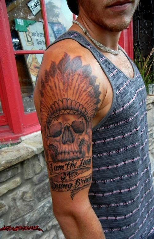 Big American native black ink Indian skull tattoo on shoulder with lettering
