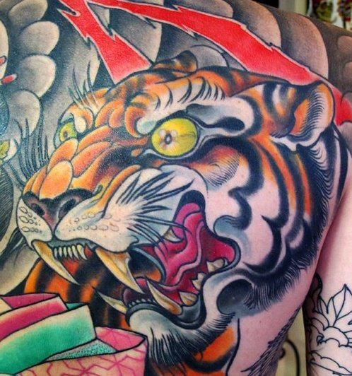 Big Asian style colored funny tiger head tattoo on back