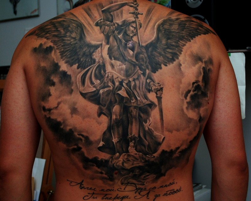 Big awesome black and white very detailed angel warrior tattoo on back with lettering