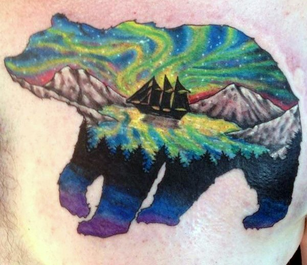 Big bear shaped magical colored tattoo with ship on shoulder