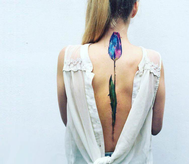 Big beautiful colored back tattoo of interesting flower