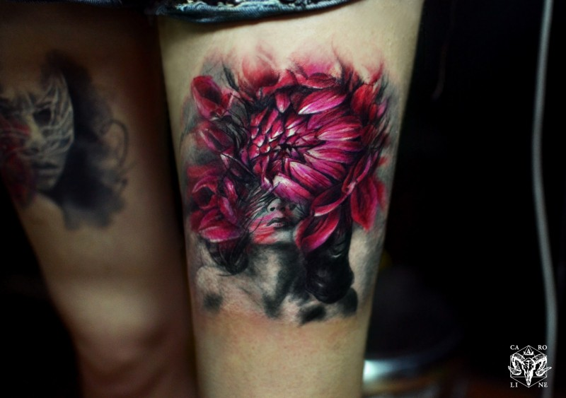 Big beautiful looking colored flower with thigh tattoo of woman portrait