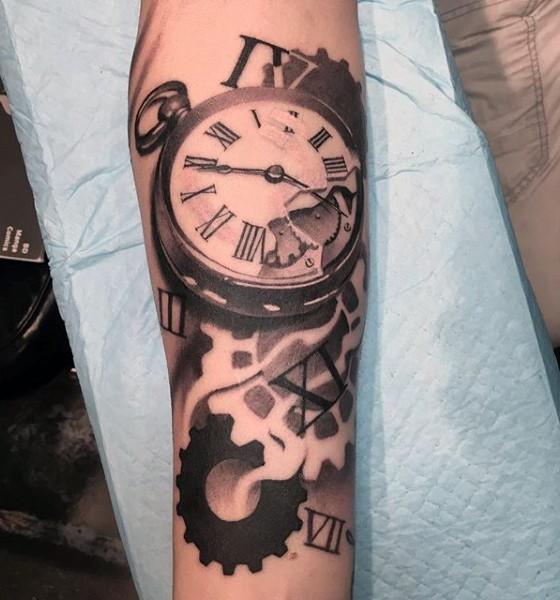 big black ad white old broken clock tattoo on arm