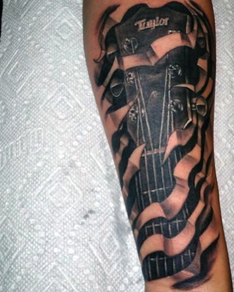 Big black and white 3D under skin guitar tattoo on arm