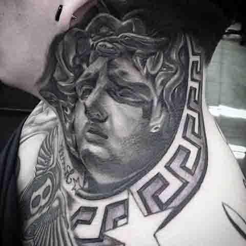 Big black and white antic Medusa statue tattoo on neck