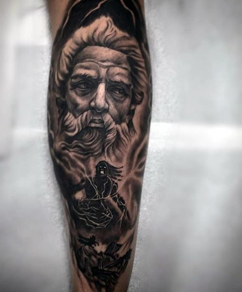 Big black and white antic statue with monster tattoo on leg