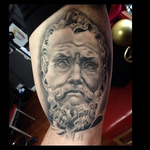 Big black and white detailed biceps tattoo of antic statue