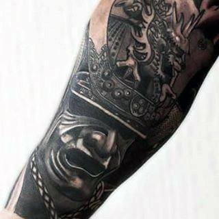 Big black and white detailed forearm tattoo of Asian samurai warriors helmet