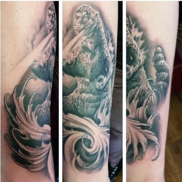 Big black and white detailed Godzilla tattoo on arm