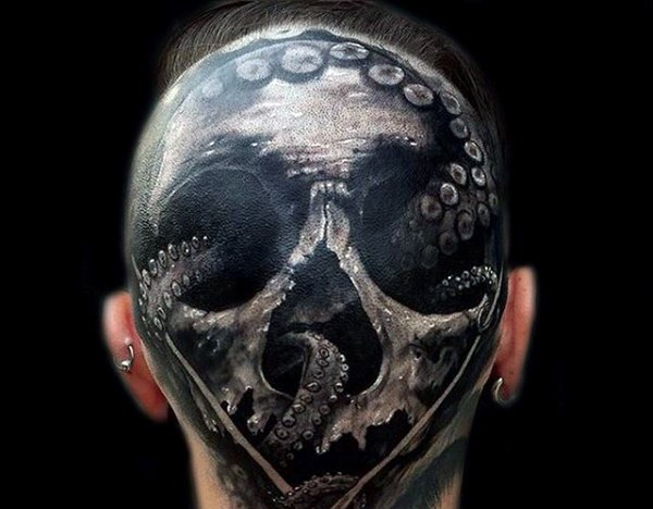 Big black and white detailed skull with octopus tattoo on head