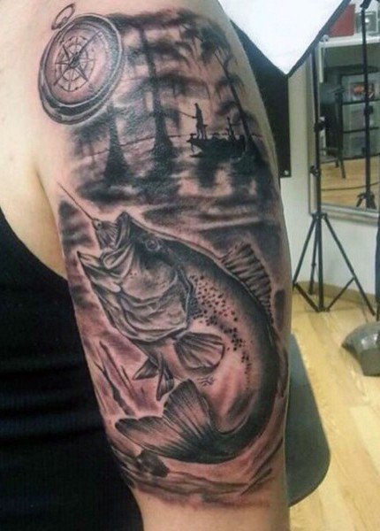 Big black and white fishing themed half sleeve tattoo