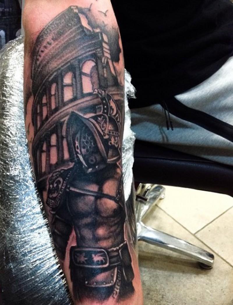 big black and white forearm tattoo of antic gladiator warrior near roman arena. Black Bedroom Furniture Sets. Home Design Ideas