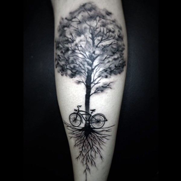 Big black and white lonely tree big bicycle tattoo on leg