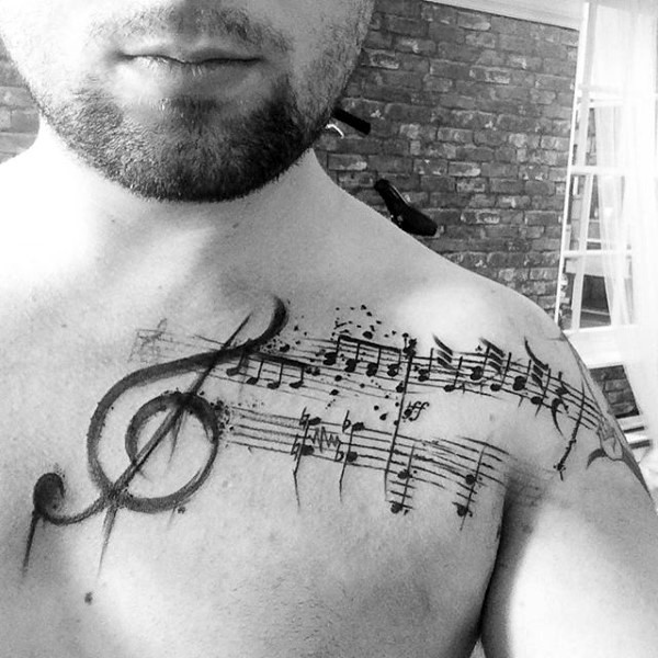 Big black and white musical notes tattoo on chest