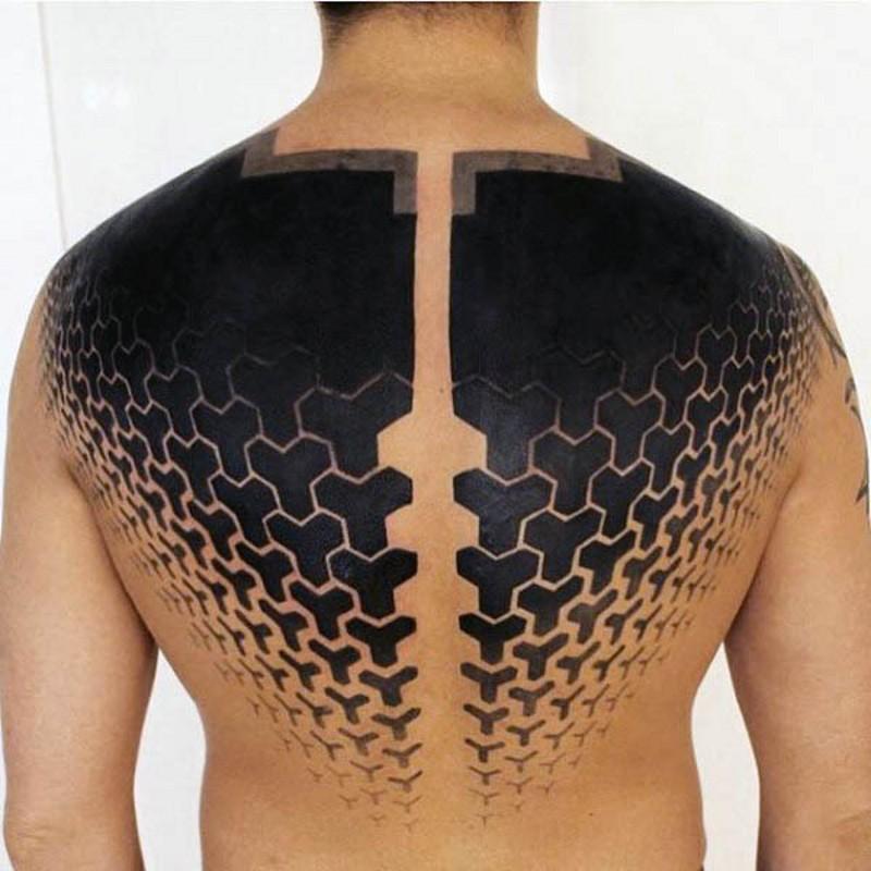 Big black and white mystic ornaments tattoo on upper back