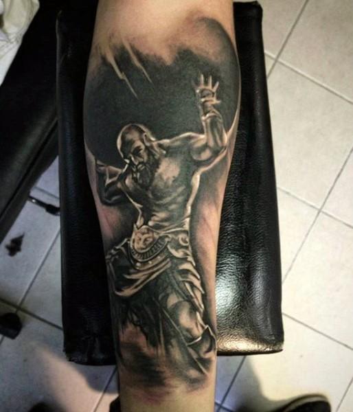 Big black and white titan like tattoo on arm