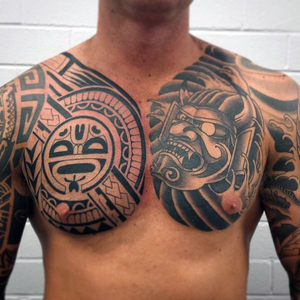 Big black and white tribal tattoo with samurai mask tattoo on chest