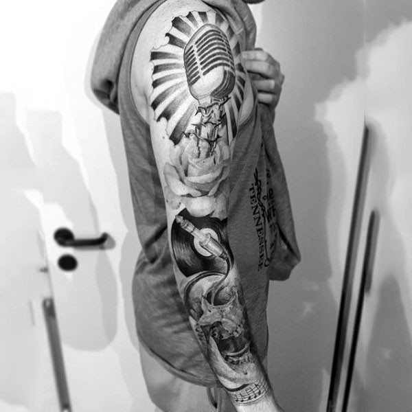 big black and white very detailed music themed tattoo on sleeve. Black Bedroom Furniture Sets. Home Design Ideas