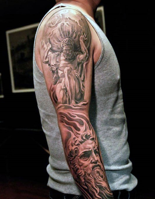 Big black and white very realistic looking antic statue tattoo on sleeve