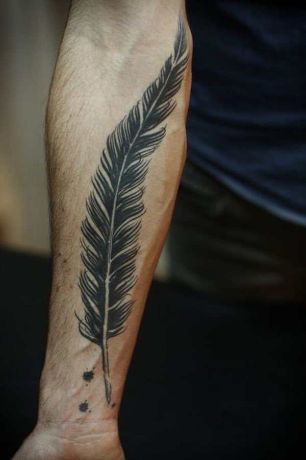 Big black feather forearm tattoo