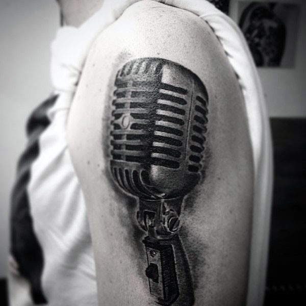 Big black ink 3D realistic vintage microphone tattoo on shoulder