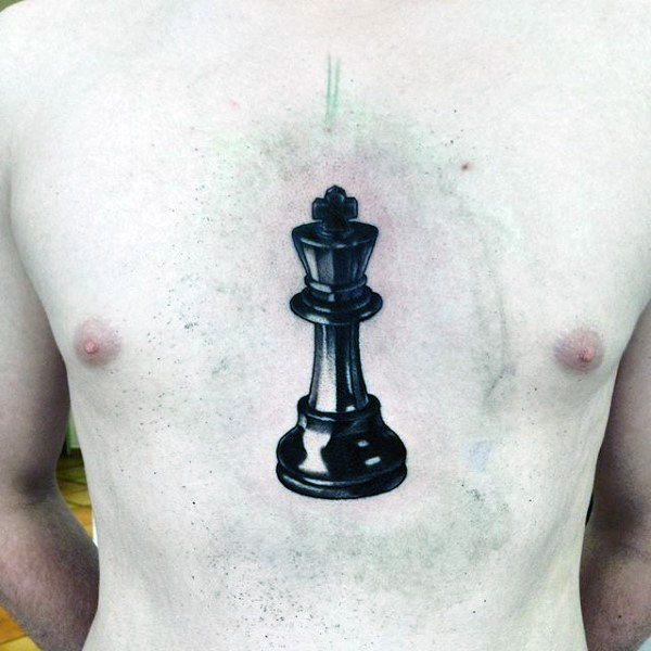 Big black ink chest tattoo of large chess figure