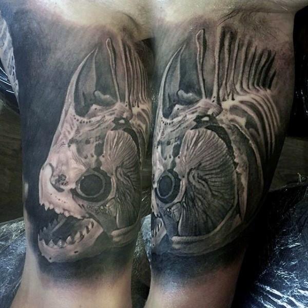 big black ink detailed black ink fish skeleton tattoo on arm. Black Bedroom Furniture Sets. Home Design Ideas
