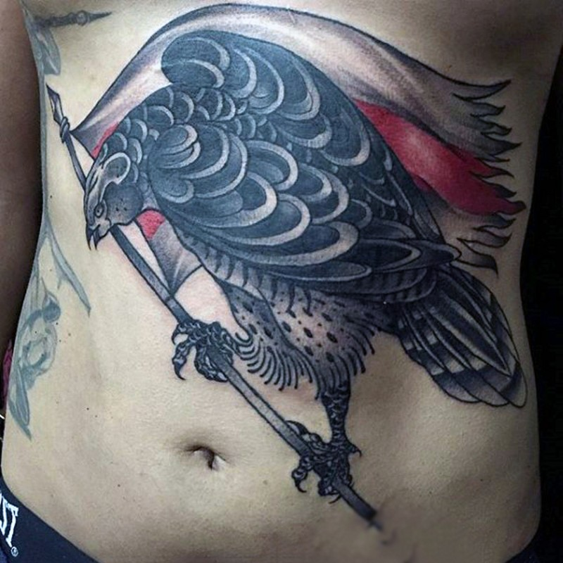 Big black ink detailed eagle tattoo on chest with national flag