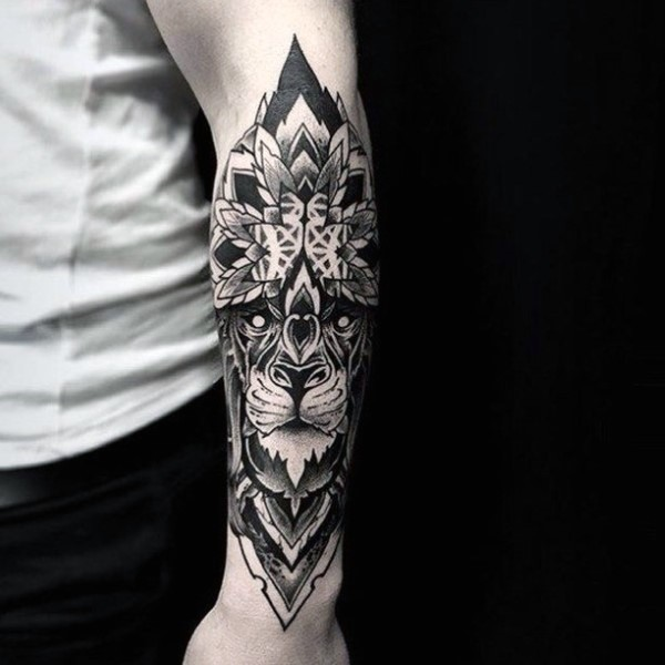 Big black ink detailed forearm tattoo of tribal style lion