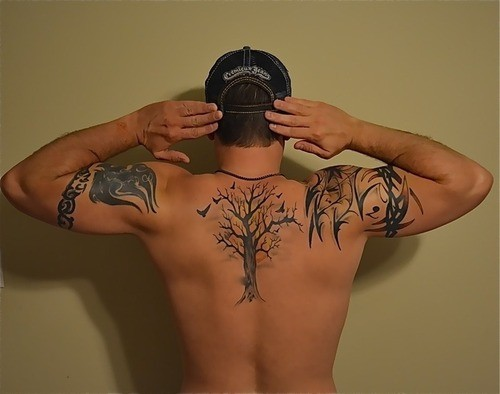 Big black ink detailed lonely tree with birds tattoo on upper back