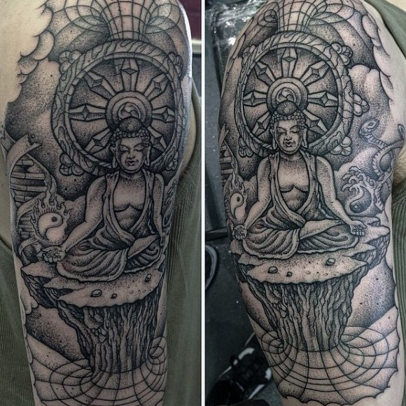 Big black ink dot style meditating Buddha tattoo on shoulder
