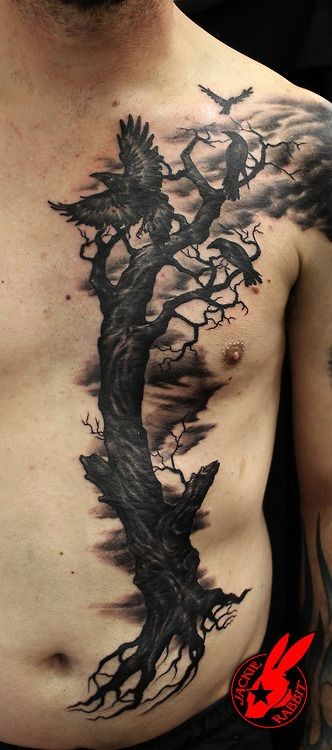 Big black ink dramatic half chest and belly tattoo of lonely dark tree with crows