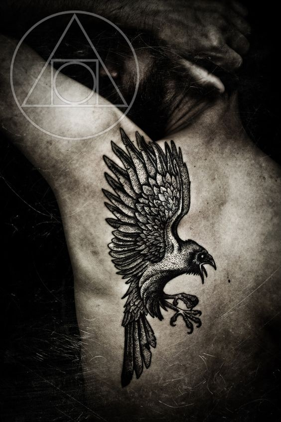 Big black ink fantasy style painted upper back tattoo of flying crow