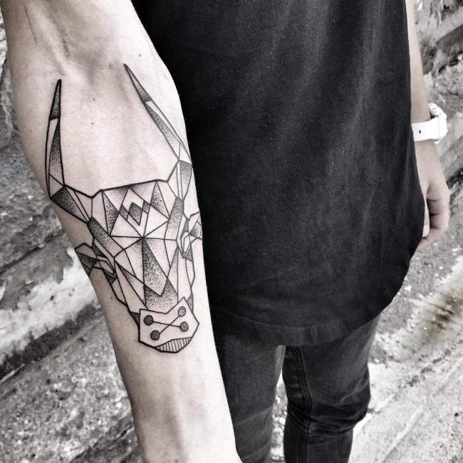 Big black ink geometrical style black ink forearm tattoo of bulls head
