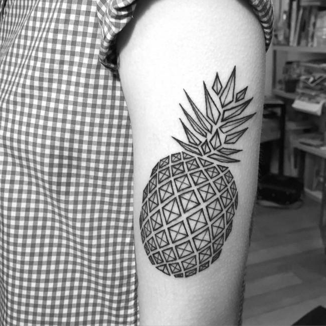 Big black ink geometrical style shoulder tattoo of pineapple