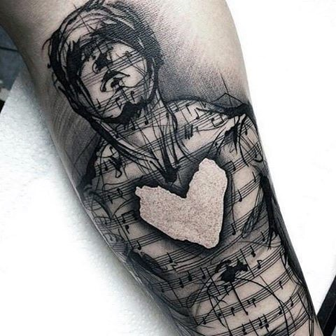 Big black ink human shaped notes with heart tattoo on arm