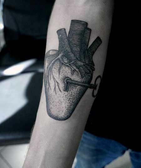 Big black ink lock shaped heart with key tattoo on arm