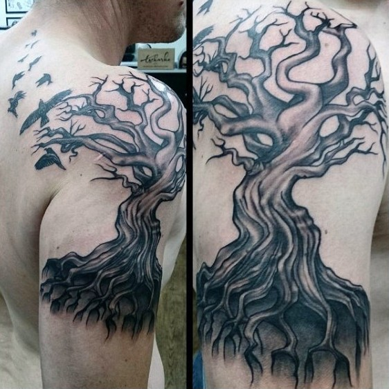 Big black ink lonely tree tattoo on shoulder zone